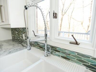 attractive kitchen with new faucet over sink